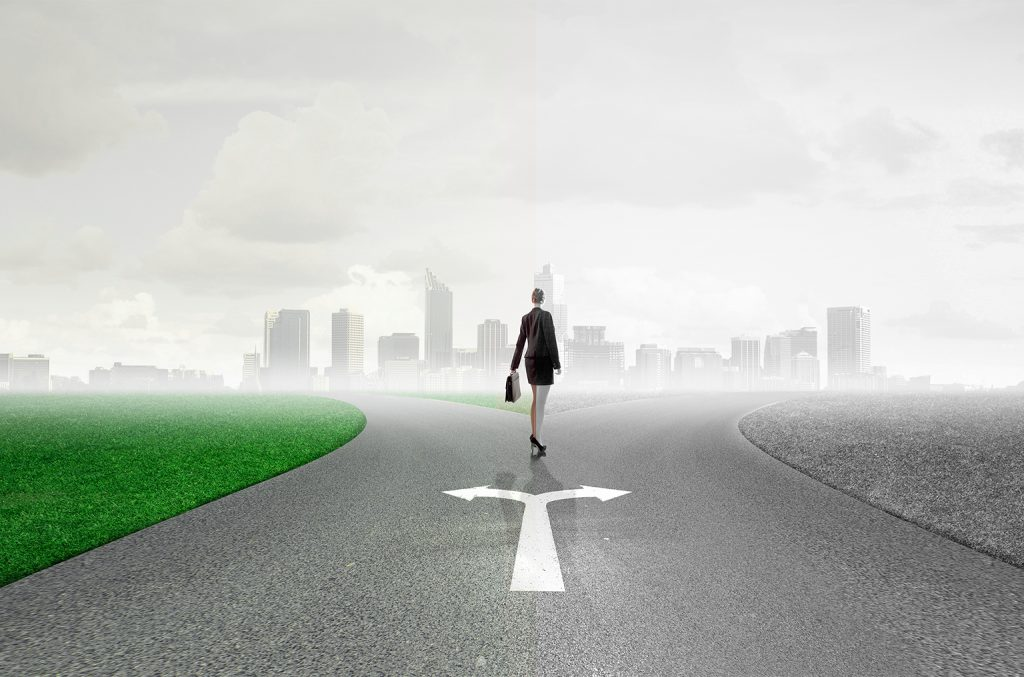 Back,view,of,businesswoman,standing,on,crossroads,and,making,choice